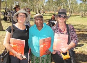 Marg Bowman, Violet Petyarre, Jenny Green holding book