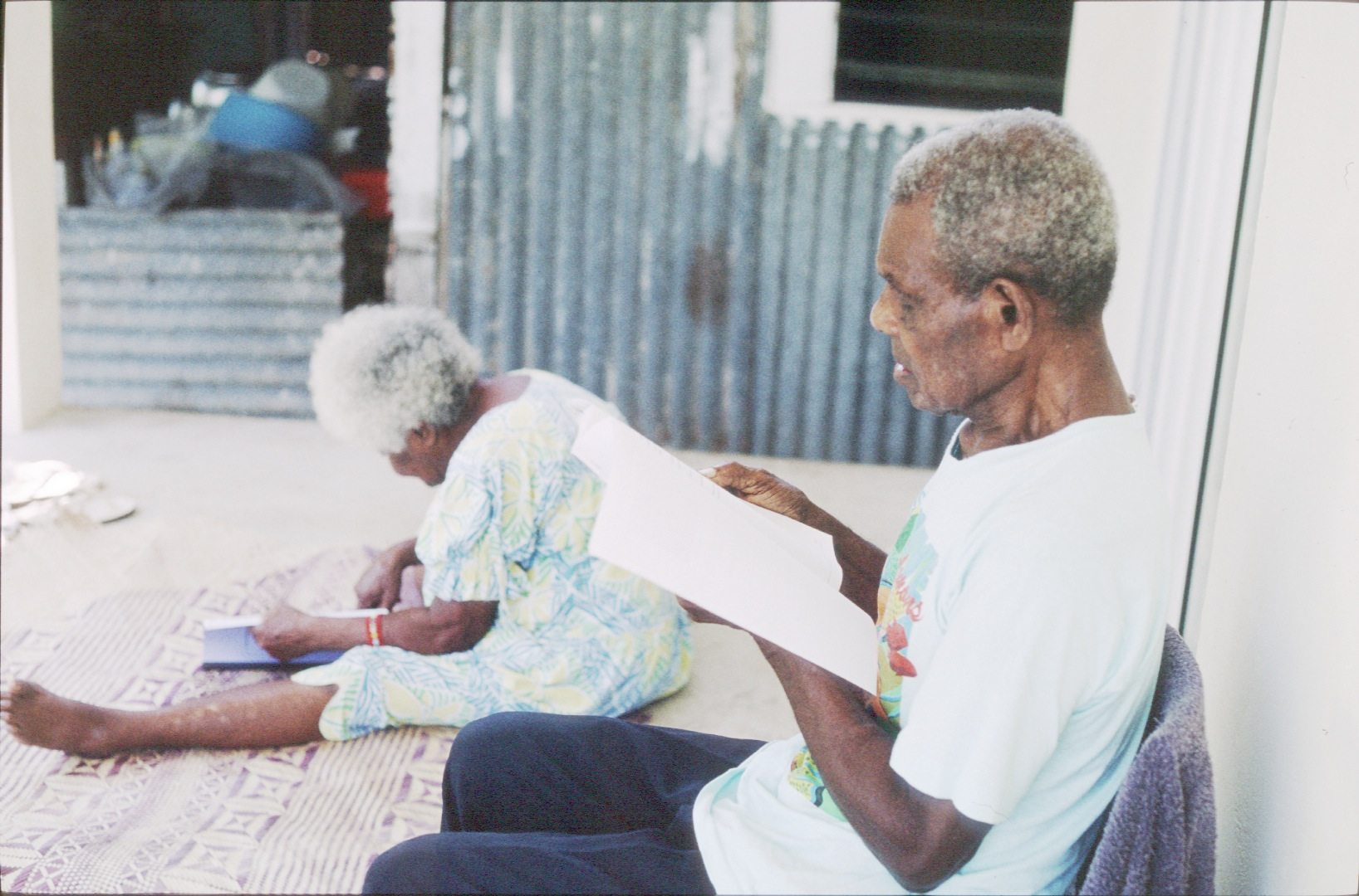 Apu Kalsarap Nemaf and Limas Kalsarap reading a dictionary of their language. Erakor village, Vanuatu, 2001.